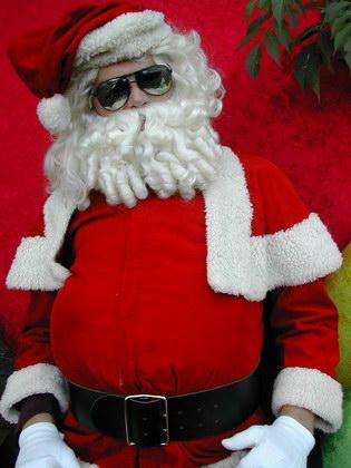Kerstman kerstvrouw en sexy kerstengel merry christmas santa claus